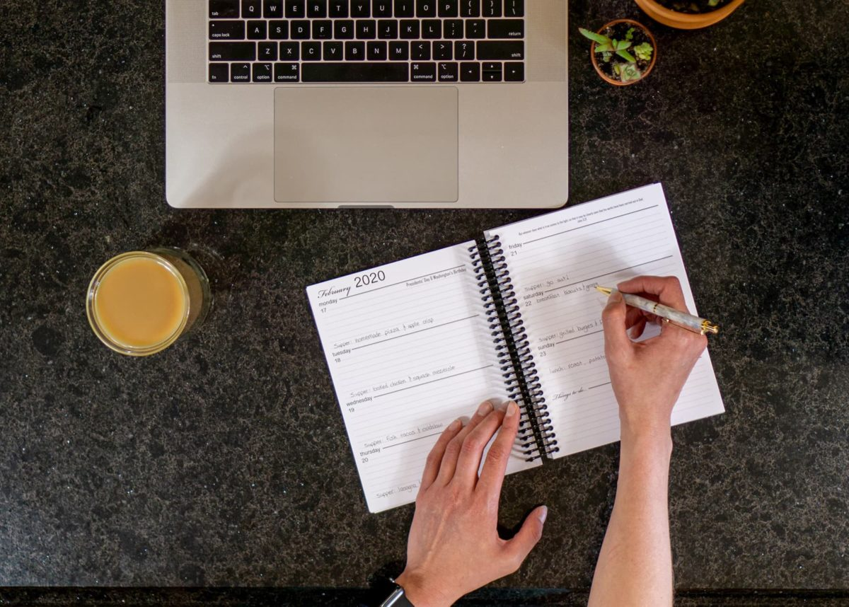 Young Woman Filling Out Weekly Planner