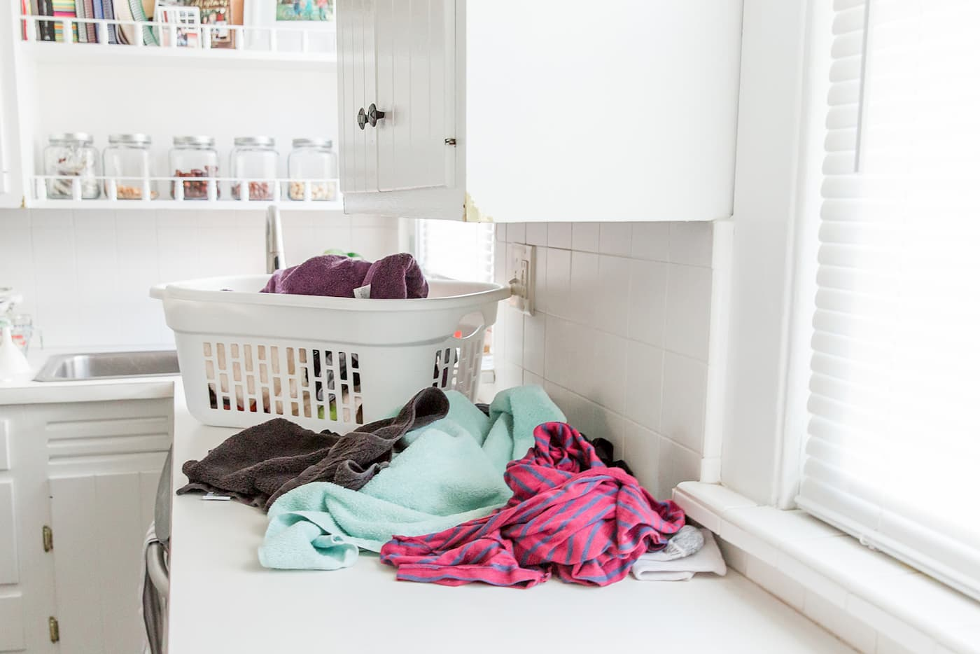 Laundry to Fold on Kitchen Countertop